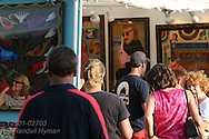 Visitors admire high-end works of art for sale in various media at the St. Louis Art Fair; Clayton, Missouri.