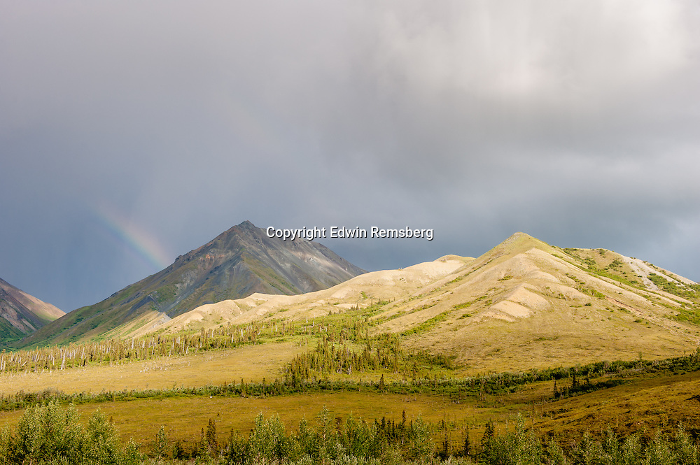 Rainbow falling over mountains in Alaska