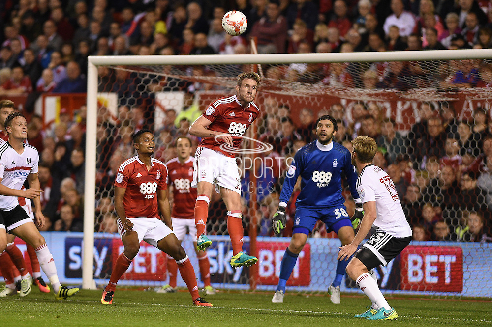 Nottingham Forest defender Damien Perquis (27) heads the ball clear during the EFL Sky Bet Championship match between Nottingham Forest and Fulham at the City Ground, Nottingham, England on 27 September 2016. Photo by Jon Hobley.