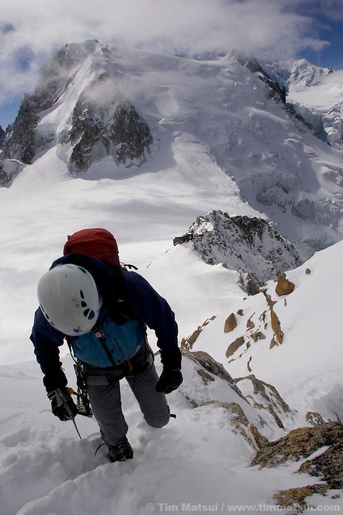 Climbers on the Arete du Cosmique, Chamonix, France.