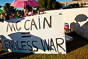 26 SEPTEMBER 2010 - PHOENIX, AZ: People use umbrellas for shade during a picket against US Sen. John McCain Sunday. About 200 people demonstrated and picketed against Arizona Republican Senator John McCain at the studios of KTVK TV in Phoenix, Sunday, Sept 26. They picketed the TV station because McCain was debating his opponents there. They were demonstrating against McCain's positions on the war in Afghanistan, Don't Ask Don't Tell (Gays in the military) and the DREAM Act (for immigrant rights). PHOTO BY JACK KURTZ