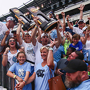 North Carolina men's and women's players pose for a photo holding their national championship trophies after both teams defeated Maryland in both Men's and Women's NCAA Division I NATIONAL CHAMPIONSHIP GAMES between North Carolina and Maryland, Monday, May. 30, 2016 at Lincoln Financial Field in Philadelphia, Pa