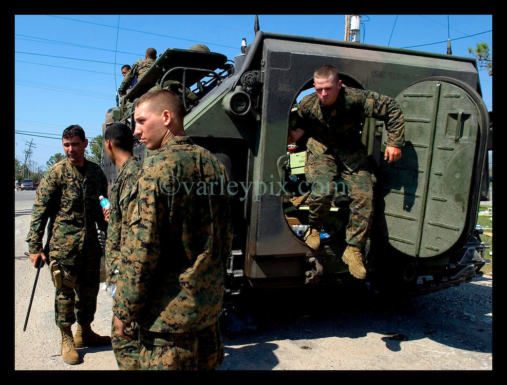 8th Sept, 2005. Hurricane Katrina aftermath. New Orleans. Marines load up in AAV's (armoured amphibious vehicles) in East New Orleans as they continue search and rescue mssions.