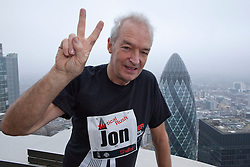 © under license to London News Pictures. 03/03/11. Channel 4 newsreader John Snow, triumphantly stands on top of Tower 42 after completing the 2011 Vertical Rush for Shelter.  1000 runners took part in the Vertical Rush event, held by Shelter to raise money to  help homeless and badly housed families across the UK. Credit should read Matt Cetti-Roberts/LNP