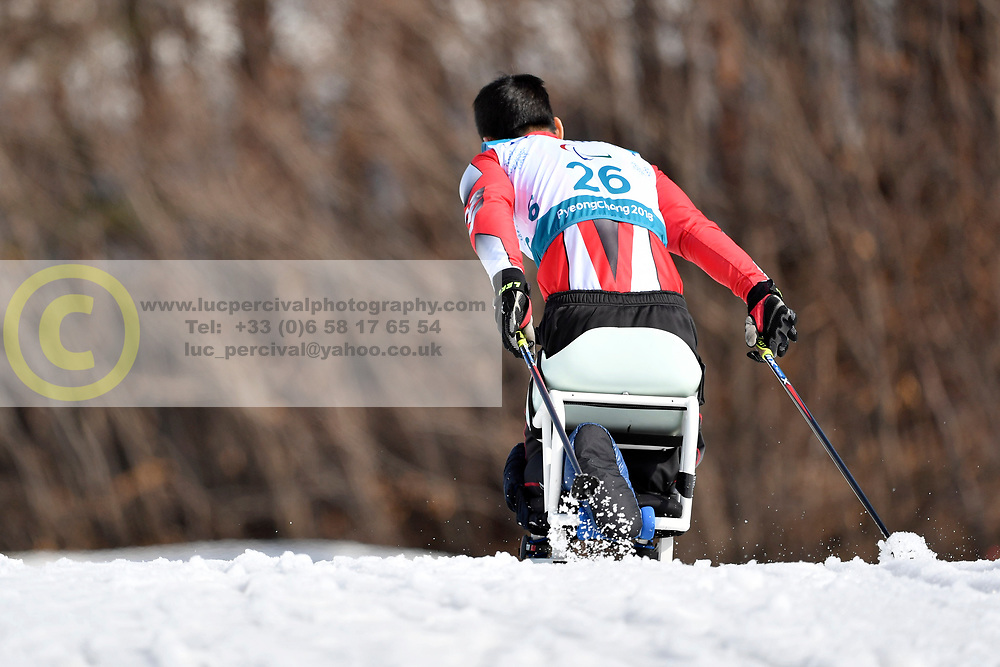 HUANG Feixiang CHN LW12 competing in the ParaSkiDeFond, Para Nordic Skiing, Sprint at  the PyeongChang2018 Winter Paralympic Games, South Korea.