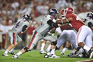 Ole Miss offensive lineman Pierce Burton (71) blocks Alabama defensive lineman Ed Stinson (49) at Bryant-Denny Stadium in Tuscaloosa, Ala. on Saturday, September 29, 2012.