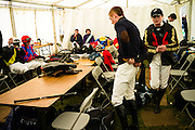 Jockey's relax in their changing area at a point-to-point in Kelso.