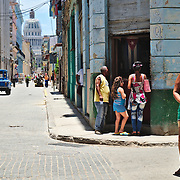The activity in the streets of la Habana Vieja, with the Capitol in the background.