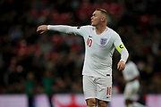 Wayne Rooney of England directs his team mates during the International Friendly match between England and USA at Wembley Stadium, London, England on 15 November 2018.