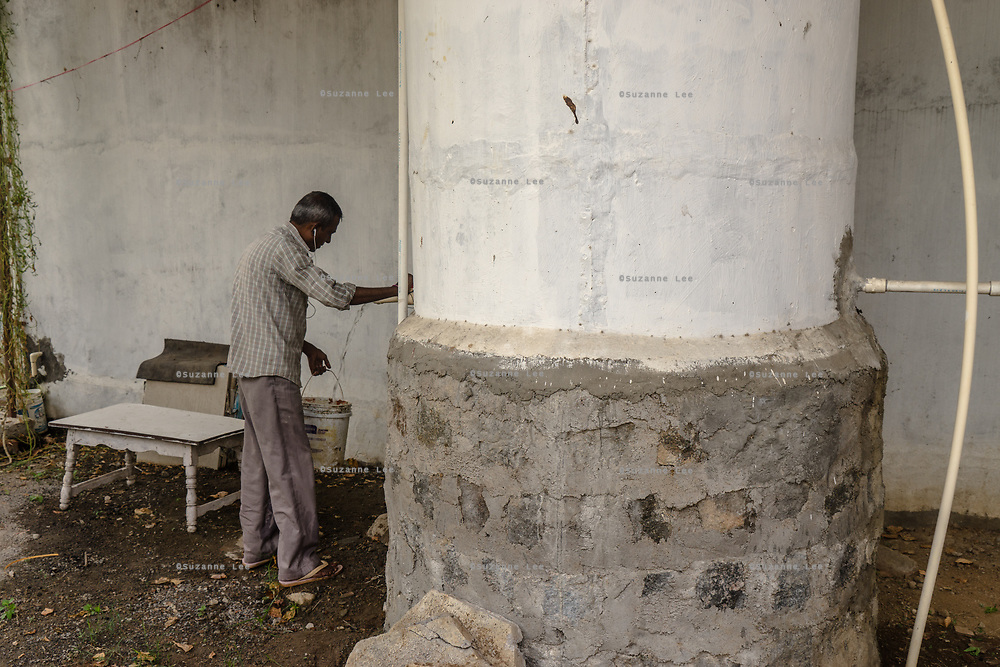 An employee fills a bucket of water at a Safe Water Network iJal station in Rangsaipet, in Waragal, Telangana, Indiia, on Saturday, February 9, 2019. Photographer: Suzanne Lee for Safe Water Network