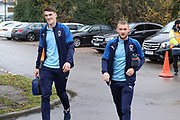 AFC Wimbledon attacker Shane McLoughlin (19) and AFC Wimbledon defender Ryan Delaney (21) arriving during the EFL Sky Bet League 1 match between AFC Wimbledon and Gillingham at the Cherry Red Records Stadium, Kingston, England on 23 November 2019.