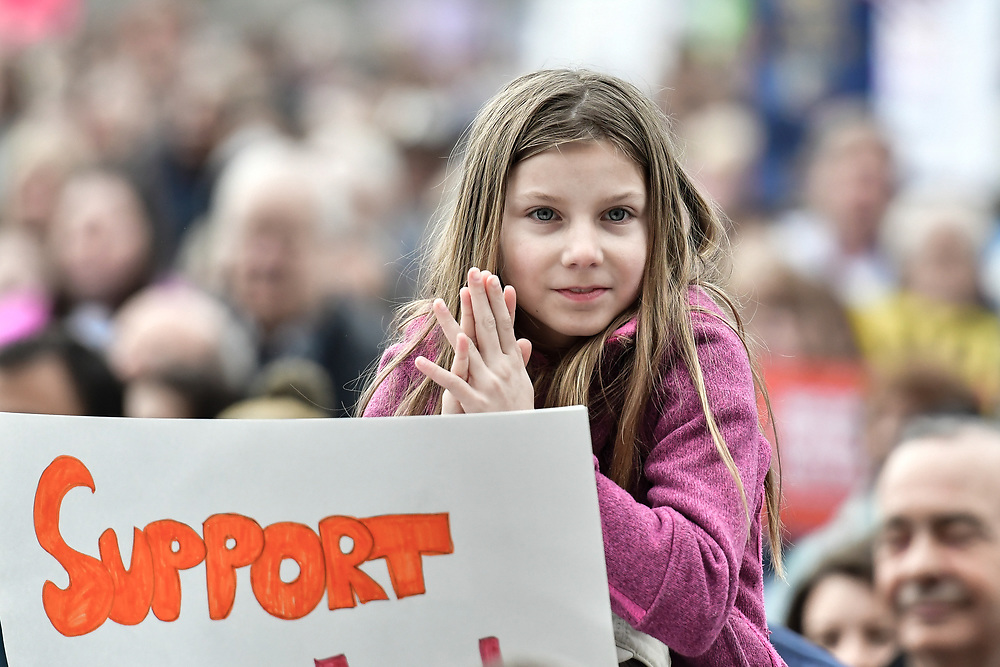 A young student holds up a sign as she listens to a speaker during The March For Our Lives demonstration against gun violence in Nashville, TN on March 24, 2018