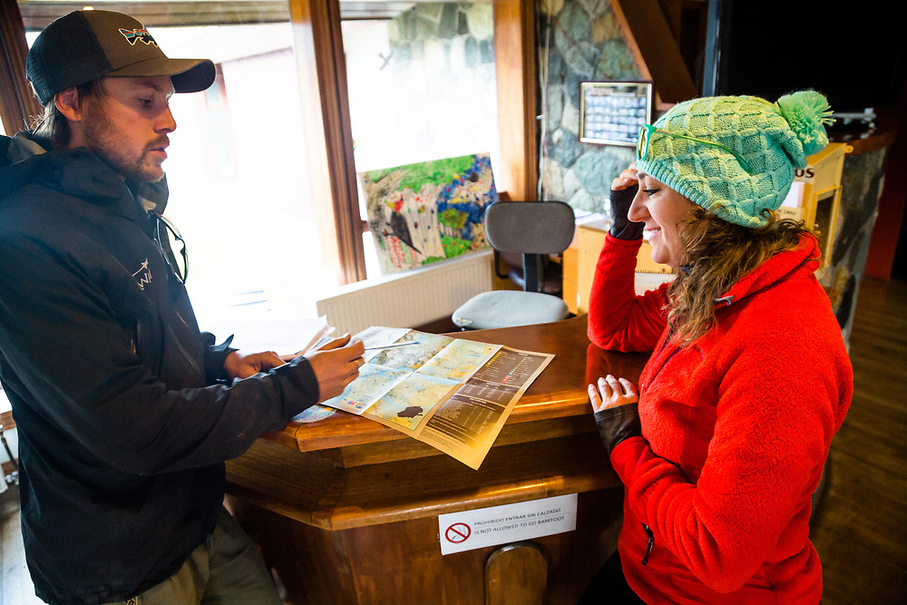 Chris (Canguro) Theobald and Heather Goodrich discuss mountain bike trail options with park rangers.