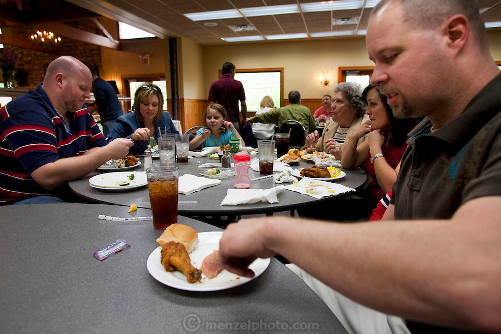 After church, coal miner Todd Kincer and his wife, Christy, join extended family and friends at an all-you-can-eat restaurant buffet in Whitesburg, Kentucky. (From the book What I Eat: Around the World in 80 Diets.)