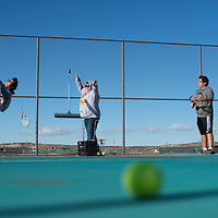 030415      Cayla Nimmo<br /> <br /> Gallup High School seniors Andrea Enoah and Gregory Winkler practice their tennis serves with captain Kelly Stapp after school Wednesday at Gallup High School.