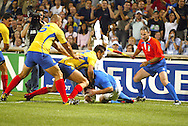 Marseille, FRANCE - 12th September 2007, The linesman looks on as Carlo Festuccia is tackled during the Rugby World Cup, pool C, match between Italy and Romania held at the Stade Velodrome in Marseille, France...Photo: Ron Gaunt/ Sportzpics