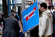Frankfurt am Main | 26 Apr 2014<br /> <br /> Am Samstag (26.04.2014) veranstalten Aktivisten der rechtspopulistischen AfD (Alternative f&uuml;r Deutschland) auf der Leipziger Stra&szlig;e in Frankfurt-Bockenheim einen Infostand, sie versuchen, Infomaterial und Flugbl&auml;tter an Passanten zu verteilen, um f&uuml;r die Partei im laufenden Europawahlkampf zu werben.<br /> Die AfD-Wahlk&auml;mpfer werden durchgehend von etwa 50 linksradikalen Aktivisten gest&ouml;rt und behindert.<br /> hier: Gegen 15 Uhr packen die AfD-Aktivisten ihren kleinen Info-Stand wieder ein. <br /> <br /> &copy;peter-juelich.com<br /> <br /> [No Model Release | No Property Release]