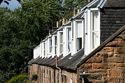 Exterior view of row of windows of Colony style terraced houses in Stockbridge, Edinburgh, Scotland, UK