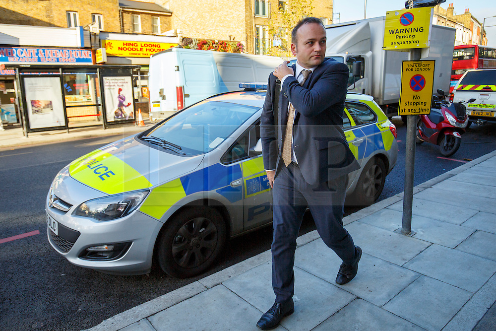 © Licensed to London News Pictures. 04/12/2015. London, UK. Labour MP Neil Coyle, who voted for Syria airstrikes leaving his police protected office after receiving death threats on Twitter on Friday, 4 December 2015. Photo credit: Tolga Akmen/LNP