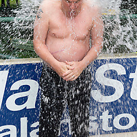 St Johnstone Manager Tommy Wright is subjected to the Ice Bucket Challenge by Tom Scobbie and Fraser Wright...29.08.14<br /> Picture by Graeme Hart.<br /> Copyright Perthshire Picture Agency<br /> Tel: 01738 623350  Mobile: 07990 594431