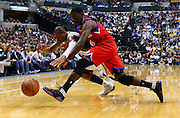 April 21, 2012; Indianapolis, IN, USA; Indiana Pacers shooting guard Leandro Barbosa (28) and Philadelphia 76ers point guard Jrue Holiday (11) scramble for a loose ball at Bankers Life Fieldhouse. Mandatory credit: Michael Hickey-US PRESSWIRE