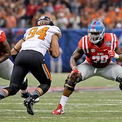 Jan 1, 2016; New Orleans, LA, USA; Mississippi Rebels offensive lineman Laremy Tunsil (78) blocks Oklahoma State Cowboys defensive end Jordan Brailford (94) during the second quarter in the 2016 Sugar Bowl at the Mercedes-Benz Superdome. Mandatory Credit: Derick E. Hingle-USA TODAY Sports