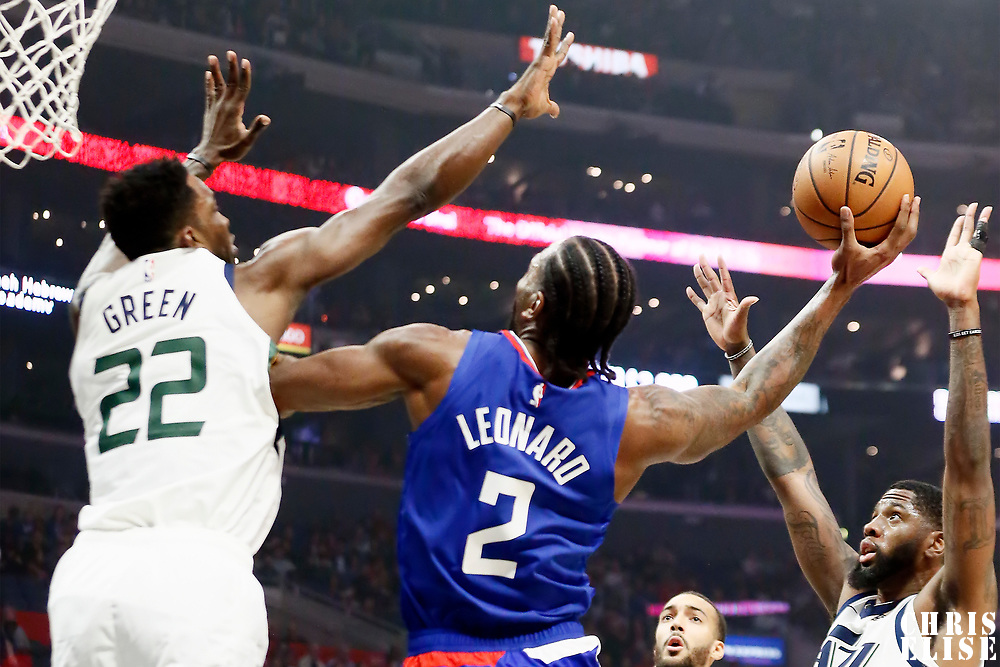 LOS ANGELES, CA - NOV 3: Kawhi Leonard (2) of the LA Clippers shoots the ball against Jeff Green (22) of the Utah Jazz during a game on November 3, 2019 at the Staples Center, in Los Angeles, California.