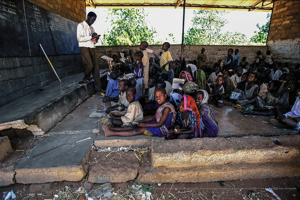 In order to create minimal learning conditions, it is not enough just to go to school. At this public school, a single teacher teaches all subjects to his 200 students of different ages.  Mangalmé, Chad.