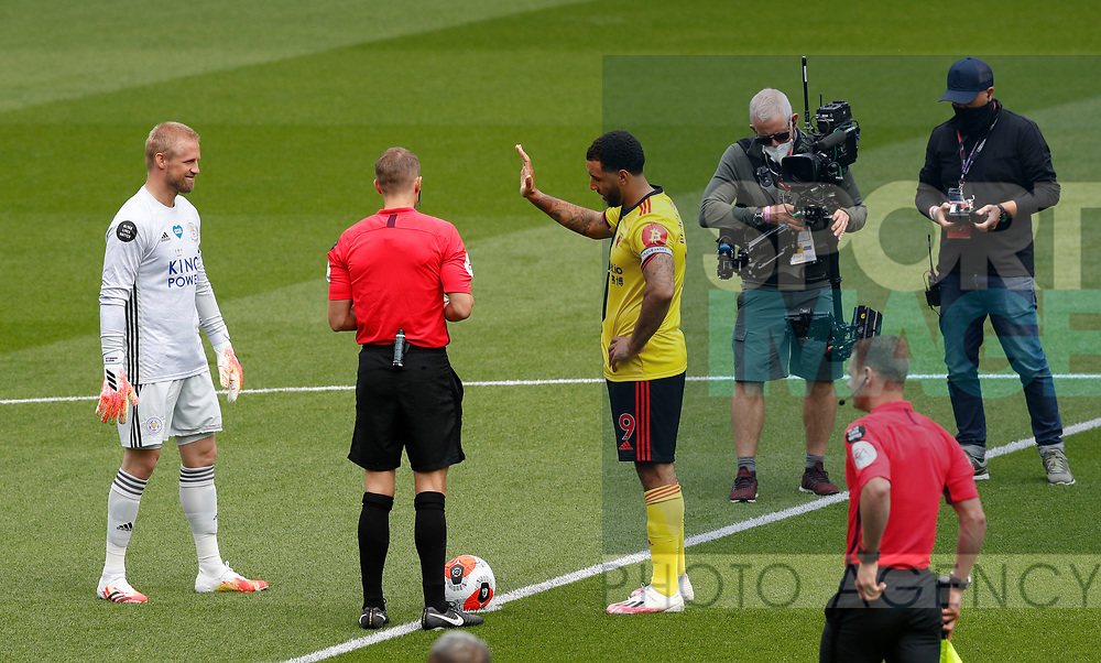 Kasper Schmeichel of Leicester City and Troy Deeney of Watford decide the coin toss before the Premier League match at Vicarage Road, Watford. Picture date: 20th June 2020. Picture credit should read: Darren Staples/Sportimage