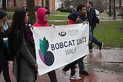 (L-R) Deepali Sharma, Lina Himawan, Elizarni, and Bina Sitepu lead with the Bobcat Unity Walk banner on College Green on Tuesday, Feb. 28, 2017. © Ohio University / Photo by Kaitlin Owens