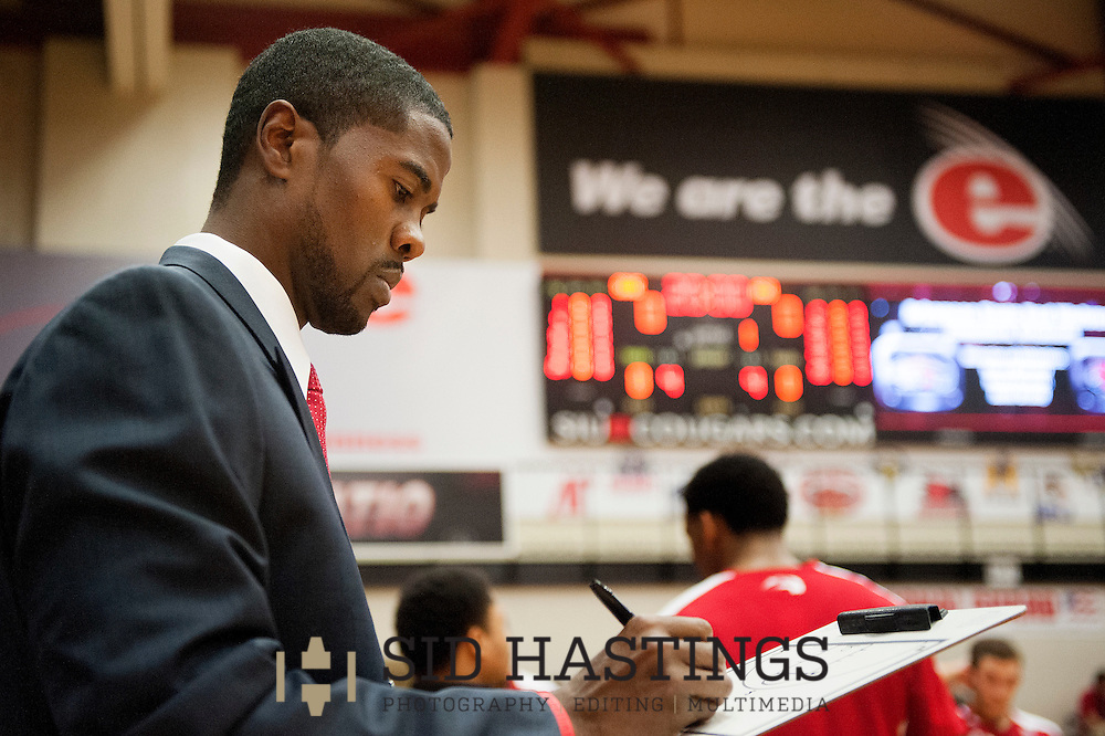 13 NOV. 2015 -- EDWARDSVILLE, Ill. -- Jon Harris (left), the new men's basketball coach at SIU-Edwardsville, prepares for his first game as coach at the Vadalabene Center in Edwardsville Friday, Nov. 13, 2015. Photo © copyright 2015 Sid Hastings.