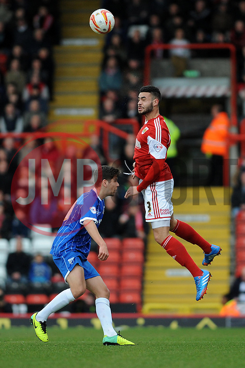 Bristol City's Derrick Williams wins a header - Photo mandatory by-line: Dougie Allward/JMP - Tel: Mobile: 07966 386802 01/03/2014 - SPORT - FOOTBALL - Bristol - Ashton Gate - Bristol City v Gillingham - Sky Bet League One
