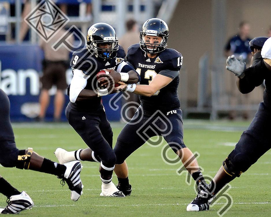 2011 September 17 - Florida International running back Kedrick Rhodes (9) takes the hand off from Florida International quarterback Wesley Carroll (13). Florida International University Golden Panthers defeated the Golden Knights of the University of Central Florida, 17-10, at the FIU Football Stadium, Miami, Florida. (Photo by: www.photobokeh.com / Alex J. Hernandez)
