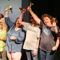 Tupelo teachers and staff celebrate as they ring their retirement bells to close out the Tupelo Public School District's end of the year convocation Thursday morning at the Performing Arts Center at Tupelo High School.