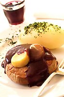 Steak Bordelaise with boiled potato, glass of red wine on back