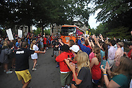 Mississippi football fans cheer as the ESPN College Gameday bus pulls in front of the Lyceum, in Oxford, Miss. on Thursday, October 2, 2014. The college football pregame show is making its first appearance at the University of Mississippi, who plays host to Alabama on Saturday (AP Photo/Oxford Eagle, Bruce Newman)