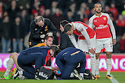 Concern grows for Per Mertesacker (Arsenal) as the doctor indicates he may have to come off during the The FA Cup fifth round match between Hull City and Arsenal at the KC Stadium, Kingston upon Hull, England on 8 March 2016. Photo by Mark P Doherty.