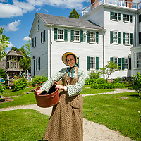 The Governors Goodwin daughter works in the garden at Strawbery Banke Museum in Portsmouth, New Hampshire.