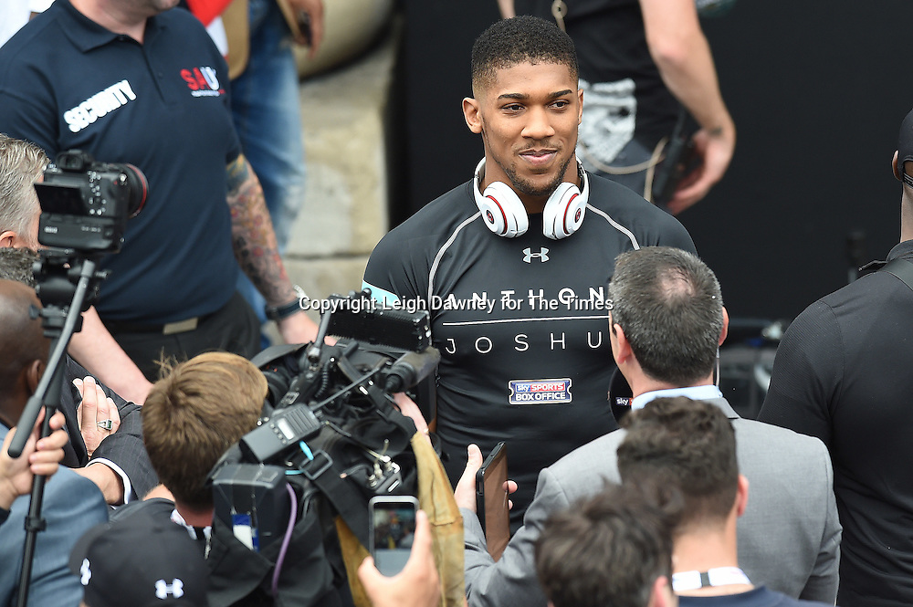 Anthony Joshua talks to the media at his weigh in against Dominic Breazela the West Piazza, Covent Garden, London on the 24th June 2016 ahead of their fight at London's O2 Arena on the 25th June 2016. © Leigh Dawney for The Times.
