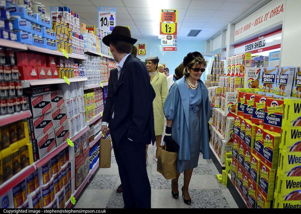 © Licensed to London News Pictures. 14/09/2012. Goodwood, UK People shop in a fully stocked vintage Tesco supermarket store. People enjoy the atmosphere at the 2012 Goodwood Revival Meeting today 14 September 2012. Participants are encouraged to dress in period dress.. Photo credit : Stephen Simpson/LNP