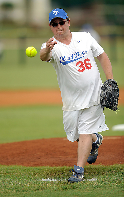 """AUGUST 19, 2009 BOCA RATON FLORIDA- Kevin Jonas Sr., father of the Jonas Brothers, delivers the pitch during their softball game against the Marquis Flyers. The Jonas Brothers and their team, the """"Road Dogs"""" took part in the softball game which was being held by Marquis Jet at the Saint Andrews School in Boca Raton, Fla. Marquis Jet has held 9 other softball games around the country as their company team the """"Marquis Flyers"""" competes in for fun games against various teams. PHOTO BY JOSH RITCHIE"""