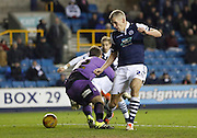 Millwall FC Forward Steve Morison (C) forces and error from Colchester FC Goalkeeper Jamie Jones during the Sky Bet League 1 match between Millwall and Colchester United at The Den, London, England on 21 November 2015. Photo by Andy Walter.