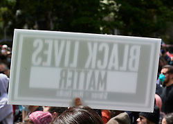 """The back of a sign stating """"Black Lives Matter"""" is seen at a June 7, 2020, Black Lives Matter protest in Eugene, Oregon. Participants protested the murder of George Floyd and other African-Americans by police."""