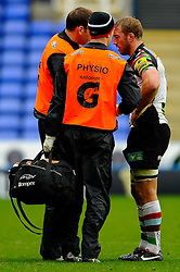 Harlequins and England captain Chris Robshaw is treated by the physios before going off injured during the first half of the match - Photo mandatory by-line: Rogan Thomson/JMP - Tel: Mobile: 07966 386802 28/10/2012 - SPORT - RUGBY - Madejski Stadium - Reading. London Irish v Harlequins - Aviva Premiership