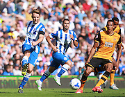 Brighton central midfielder Dale Stephens passes the ball wide under pressure fromHull City defender Isaac Hayden during the Sky Bet Championship match between Brighton and Hove Albion and Hull City at the American Express Community Stadium, Brighton and Hove, England on 12 September 2015. Photo by Bennett Dean.