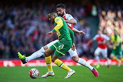 Martin Olsson of Norwich City under pressure from Olivier Giroud of Arsenal - Mandatory byline: Jason Brown/JMP - 07966386802 - 30/04/2016 - FOOTBALL - Emirates Stadium - London, England - Arsenal v Norwich City - Barclays Premier League