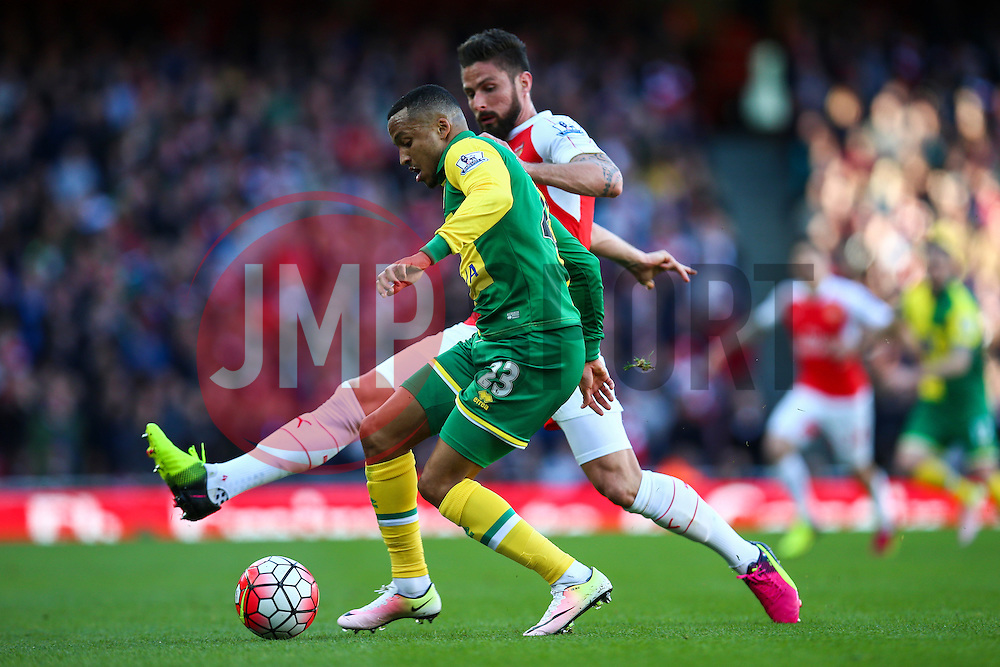 Martin Olsson of Norwich City under pressure from Olivier Giroud of Arsenal - Mandatory byline: Jason Brown/JMP - 07966386802 - 30/04/2016 - FOOTBALL - Emirates Stadium - London, England - Arsenal v Norwich City - Barclays Premier League