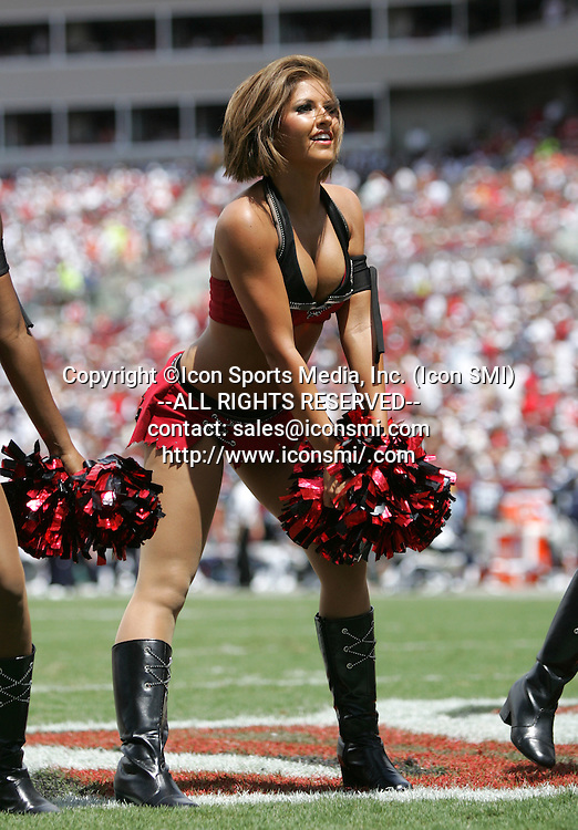13 SEP 2009: A Buccaneer cheerleader entertains the fans during the game between the Dallas Cowboys and the Tampa Bay Buccaneers at Raymond James Stadium in Tampa, Florida.