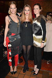 Left to right, sisters POPPY DELEVINGNE, CARA DELEVINGNE and CHLOE DELEVINGNE at the YSL Beauty: YSL Loves Your Lips party held at The Boiler House,The Old Truman Brewery, Brick Lane,London on 20th January 2015.