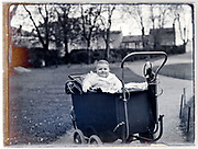 toddler in stroller posing late 1920s